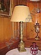 An Empire style gilt metal table lamp cast with lappetted foliage, on a square plinth 69cm high
