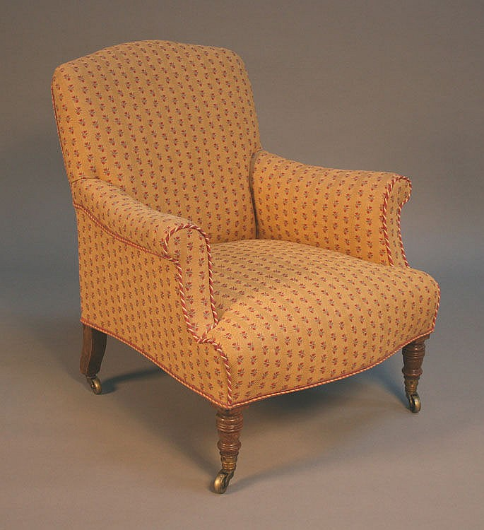 A Victorian armchair by Howard & Sons with an