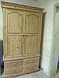 A modern pine wardrobe with 2 panelled doors above