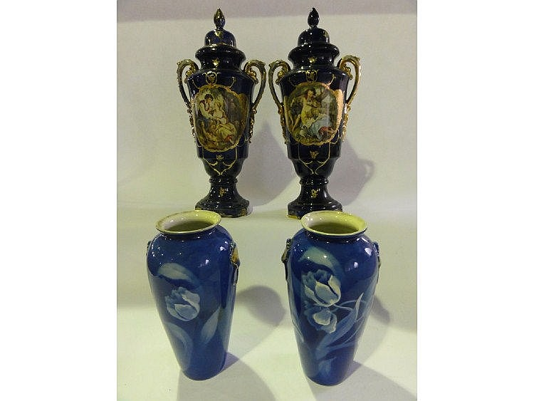A large pair of Edwardian two handled lidded vases